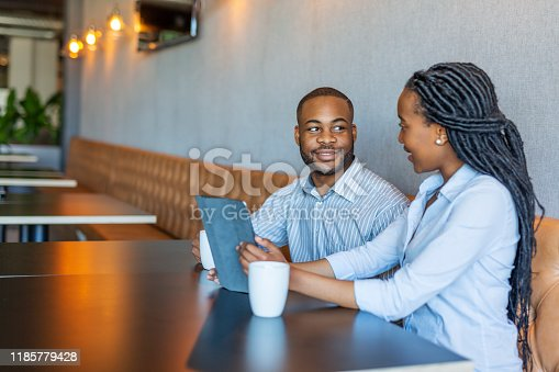 624700110istockphoto Portrait of an African Businessman and Businesswoman Having a Casual Meeting 1185779428