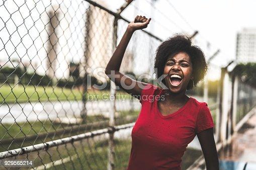 Happy woman fan in the stadium