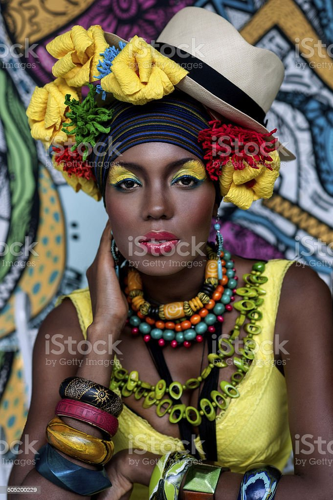 Portrait of an African girl on the background of the painting stock photo