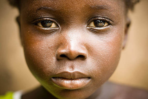 A portrait of an African girl with a sad expression A close up of an African girls face. hungry stock pictures, royalty-free photos & images