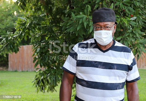 istock A portrait of an African-American man wearing a medical mask 1268471619