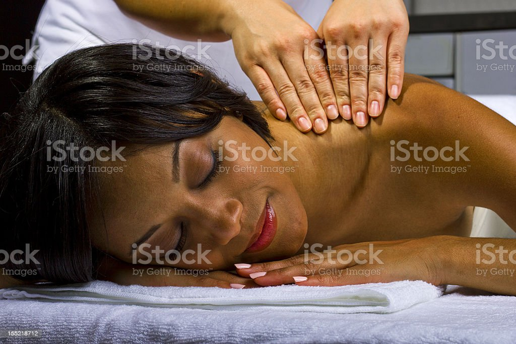 Portrait of an African-American Woman Getting a Massage royalty-free stock photo
