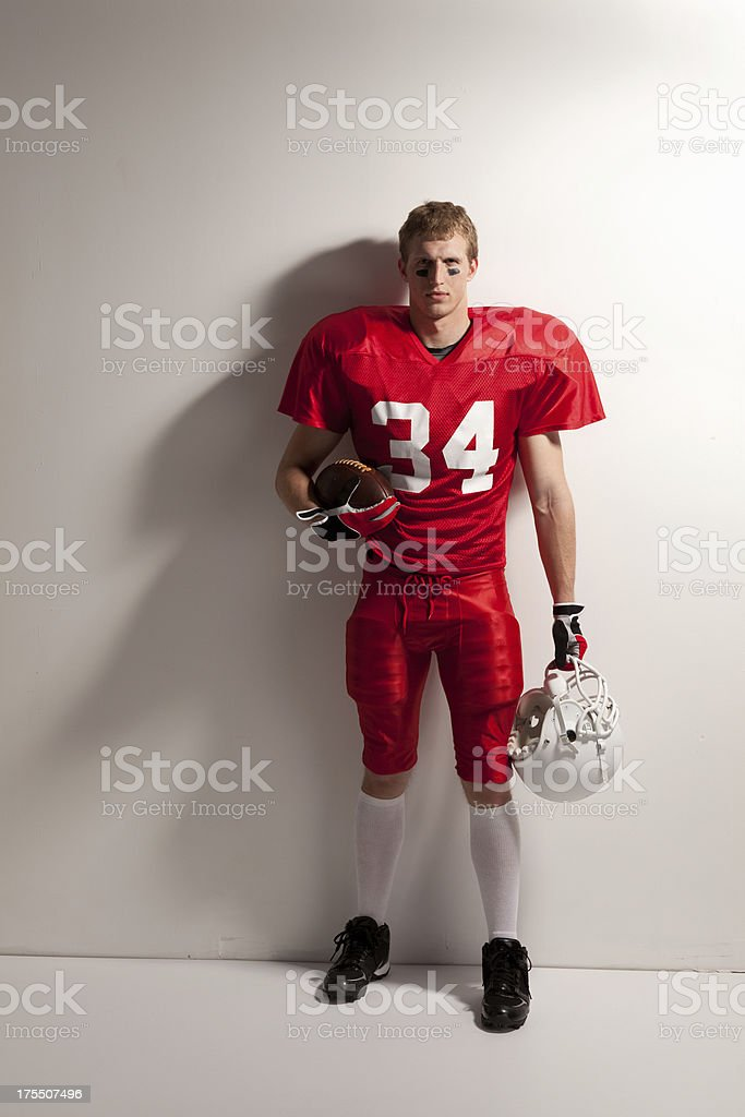 Portrait of an American football player posing stock photo