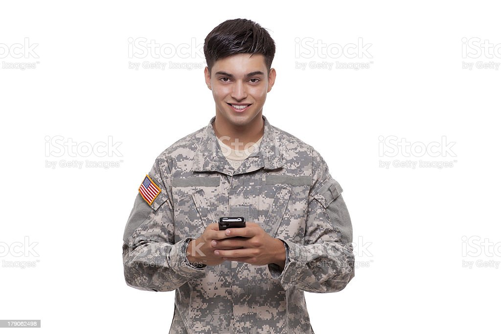 Portrait of an American soldier texting with a cell phone royalty-free stock photo