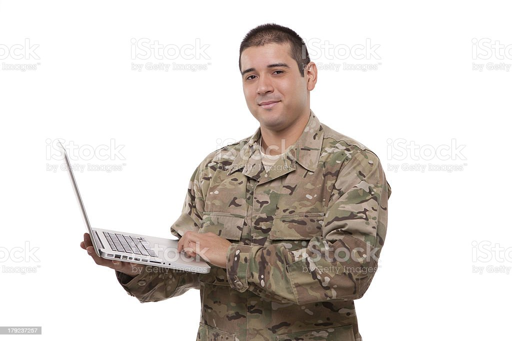 Portrait of an American soldier with a laptop royalty-free stock photo
