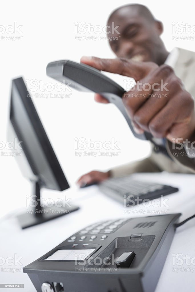 Portrait of an angry salesman hanging up stock photo