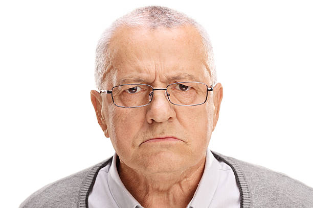 portrait of an angry senior - frowning stock photos and pictures