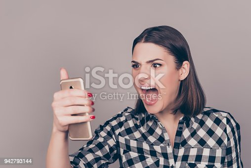 istock A portrait of an angry young woman disappointed with the news from her work and screaming on the phone 942793144