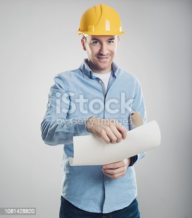 istock Portrait of an architect builder. engineer in a helmet with draw 1081428820