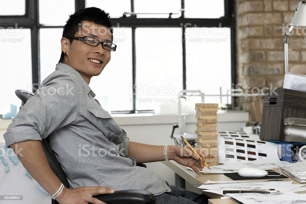 Portrait of an architect by his desk royaltyfri bildbanksbilder