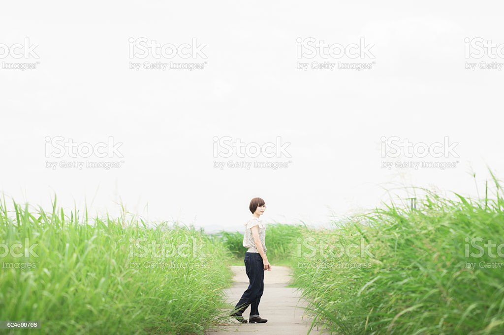 Portrait of an Asian woman in the countryside stock photo