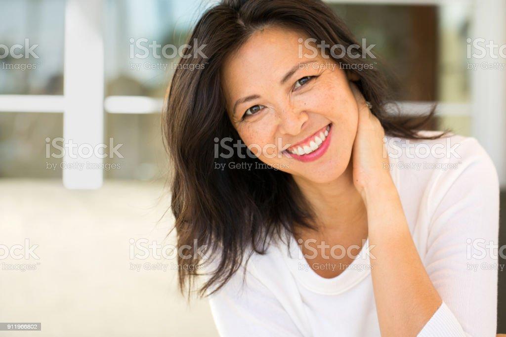 Portrait of an Asian woman smiling. Portrait of an Asian woman laughing and smiling. 2015 Stock Photo
