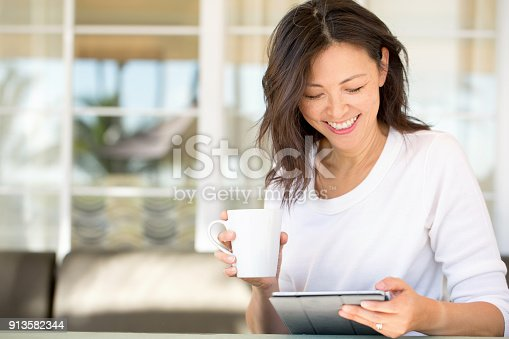 istock Portrait of an Asian woman smiling. 913582344