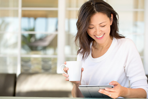 Portrait Of An Asian Woman Smiling Stock Photo - Download Image Now