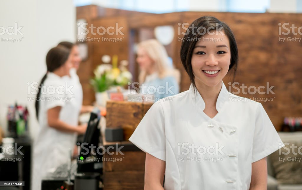 Portrait of an Asian woman working at a spa stock photo