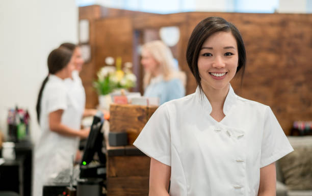 portrait of an asian woman working at a spa - beautician stock photos and pictures