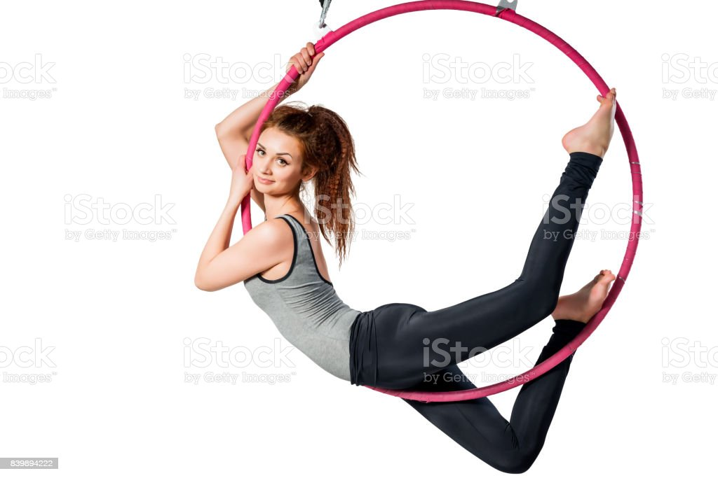 Portrait of an athlete in the air ring isolated on white background stock photo