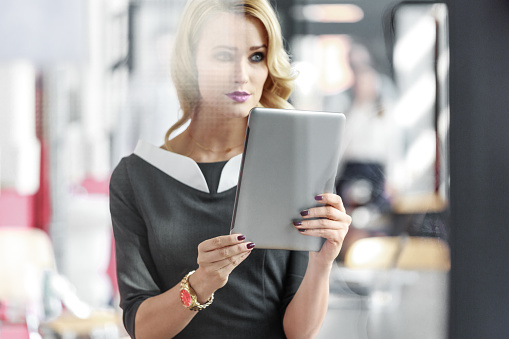 Portrait Of An Attractive Businesswoman Holding A Digital Tablet Stock Photo - Download Image Now