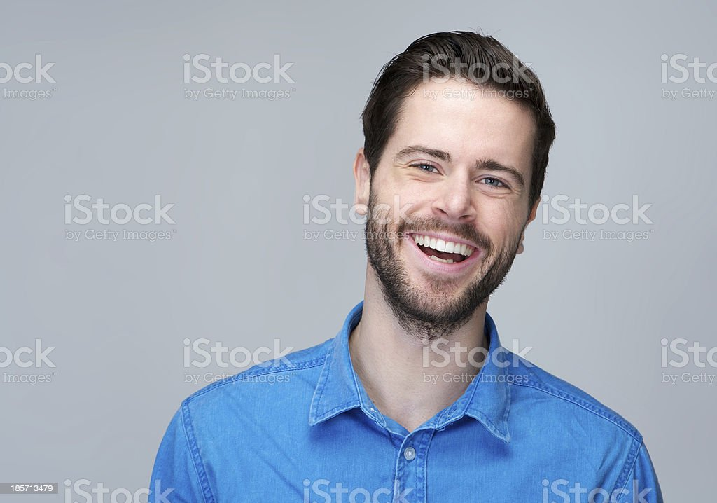 Portrait of an attractive caucasian man laughing royalty-free stock photo