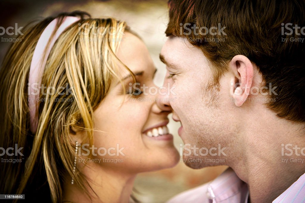 A portrait of an attractive couple about to kiss each other royalty-free stock photo