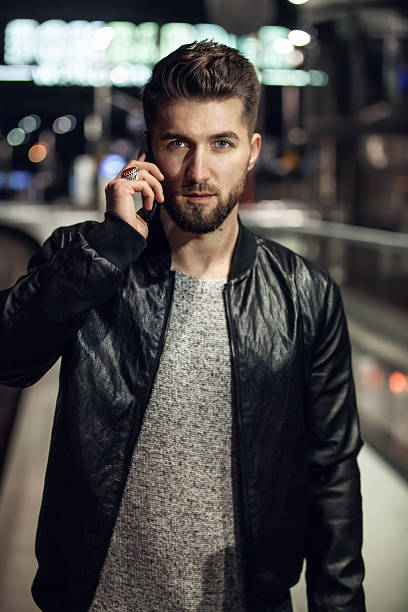 portrait of an attractive man with a smart phone - modellbahnanlagen stock-fotos und bilder