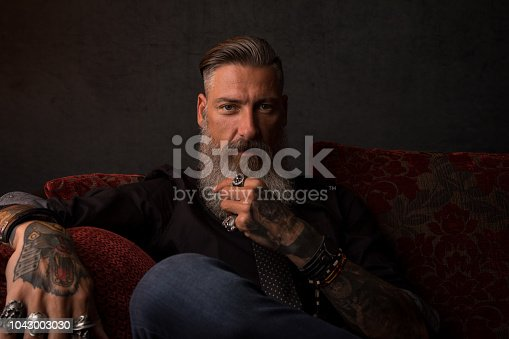Portrait of an attractive modern business man in front of a dark background