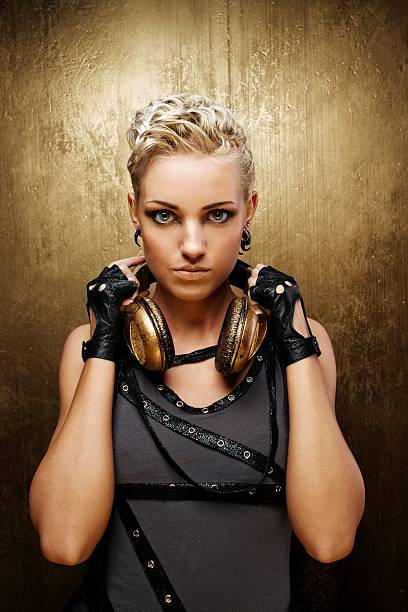Portrait of an attractive steam punk girl with headphones stock photo