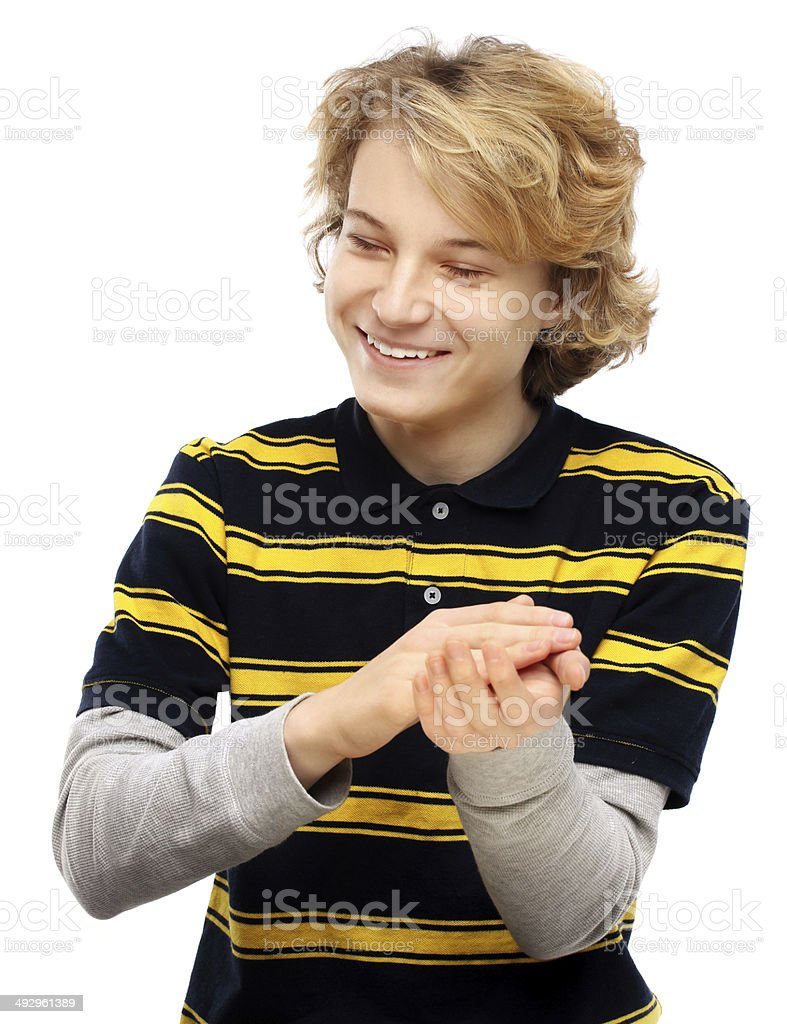 Portrait of an attractive teen clapping hands.White background royalty-free stock photo