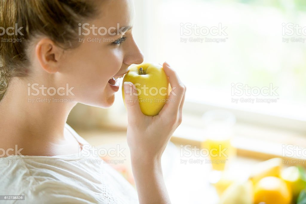 Portrait of an attractive woman eating an apple stock photo