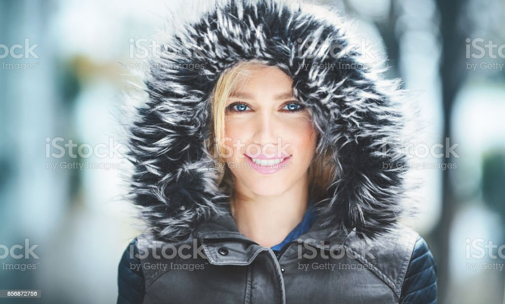 Portrait of an attractive woman in winter clothes. stock photo