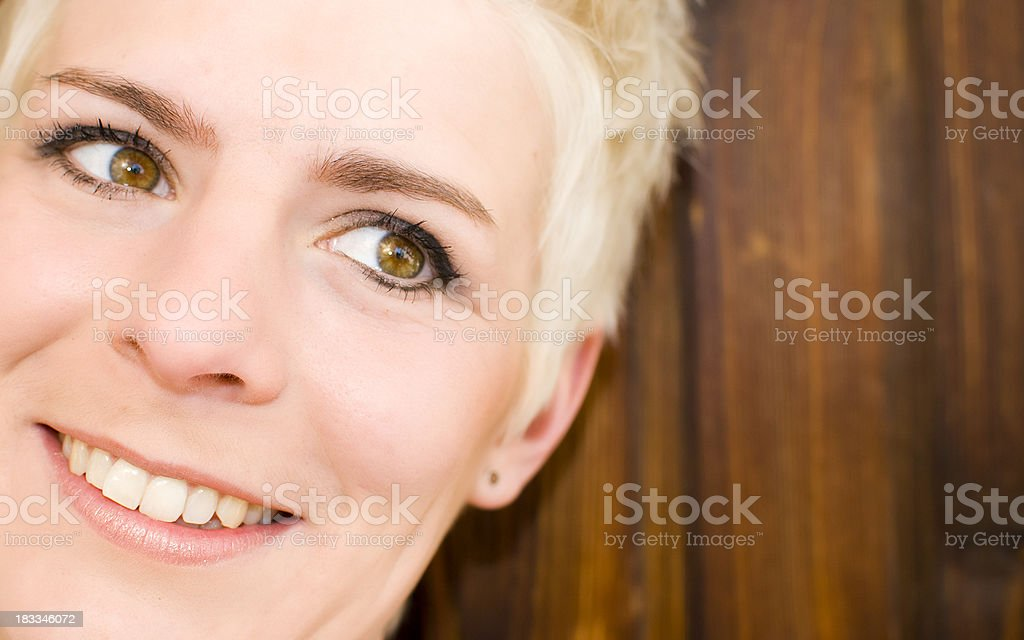 Portrait of an attractive woman with short blond hair royalty-free stock photo