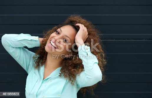 186534921 istock photo Portrait of an attractive young female laughing outdoors 461955823