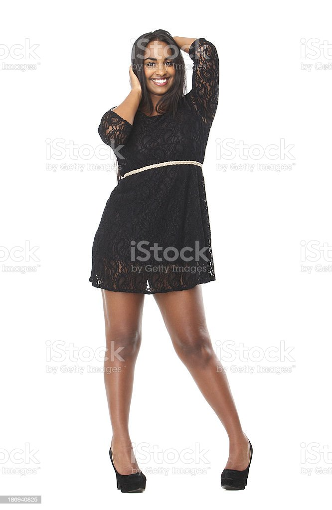 Portrait of an attractive young female with hands in hair royalty-free stock photo