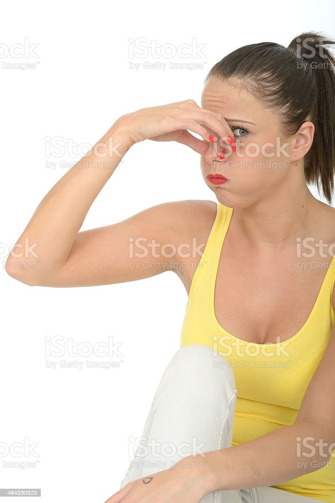 Portrait of an Attractive Young Woman Holding Her Nose stock photo