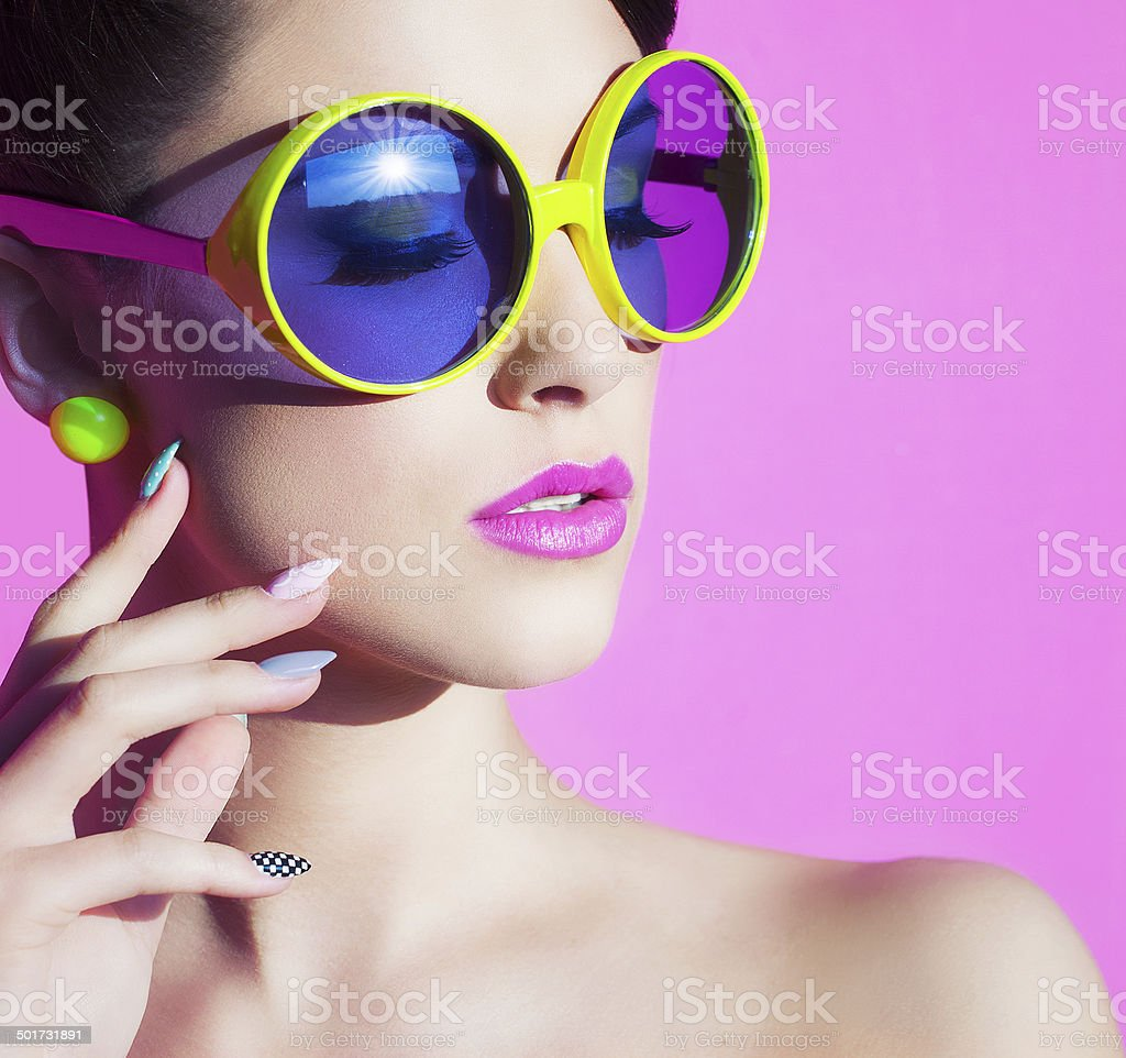 portrait of an attractive young woman with sunglasses stock photo