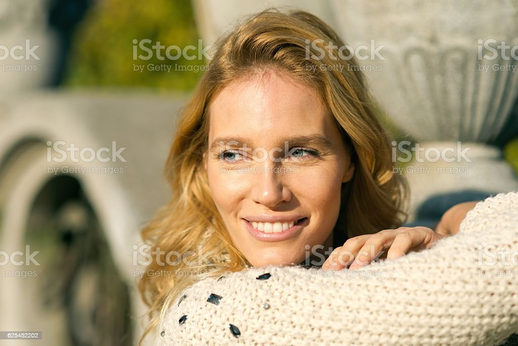 Portrait of an beautiful blondy smiling woman looking away stock photo