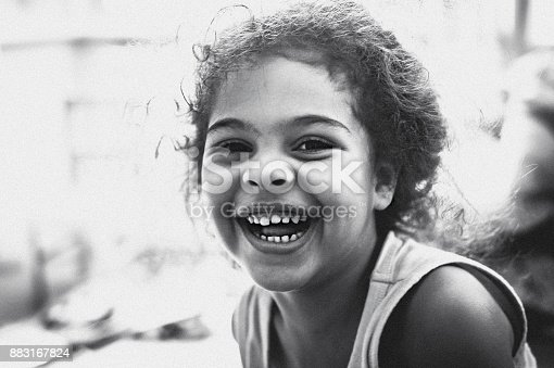 Black and white stock photo of 4 years old girl portrait who is laughing out loud.