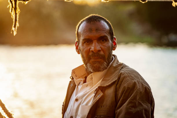 Portrait of an Egyptian fisherman at sunset. People of Egypt stock photo