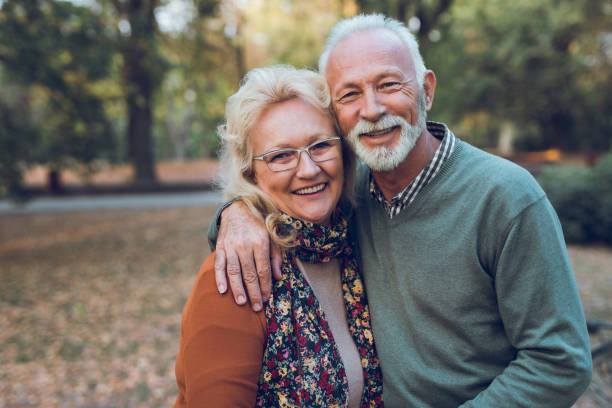 Portrait of an elderly couple in the park stock photo