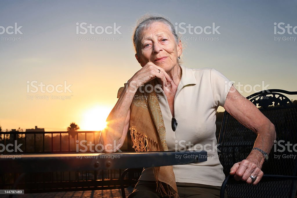 Portrait of an elderly lady at sunset royalty-free stock photo
