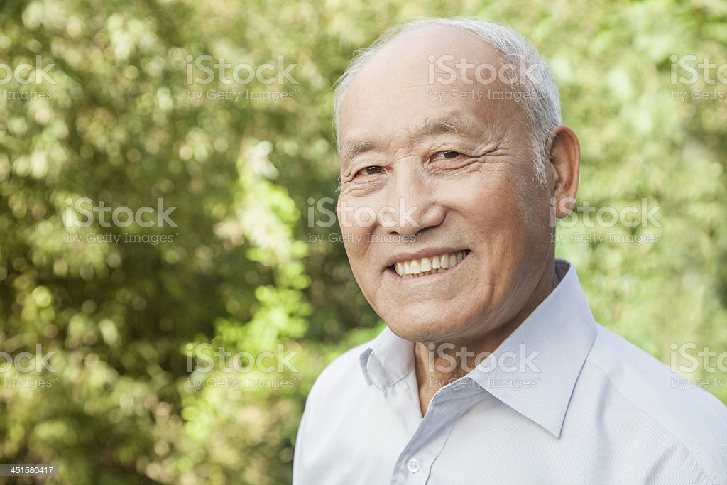 Portrait of an elderly man with a happy expression and smile stock photo