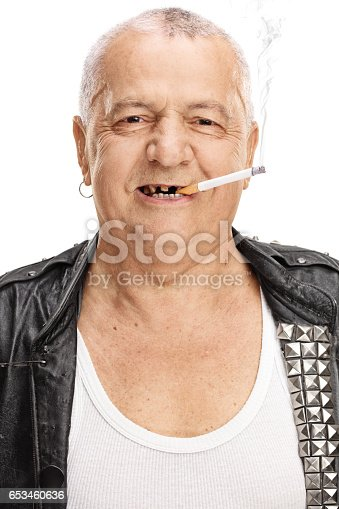 Portrait of an elderly punker with a cigarette isolated on white background