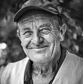 Portrait of smiling old man with wrinkled face. Black and white portrait .