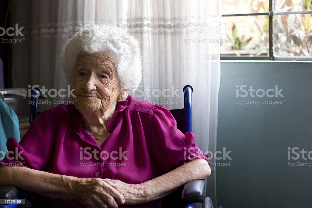 Portrait of an elderly woman in a wheelchair stock photo