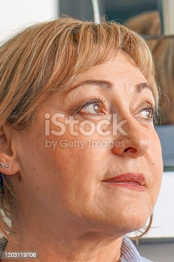 Portrait of elderly woman. Face of an agitated elderly Caucasian woman