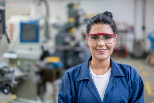 Portrait of an engineering student in a workshop stock photo