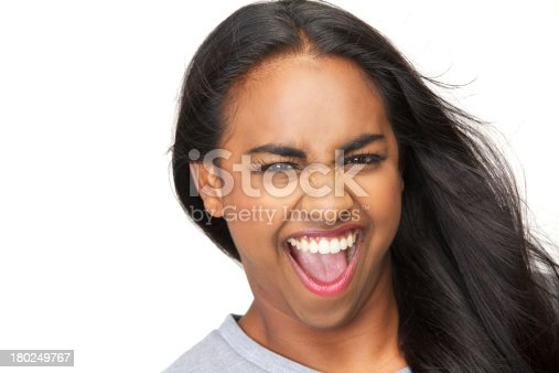 629077968istockphoto Portrait of an excited young woman with mouth open 180249767
