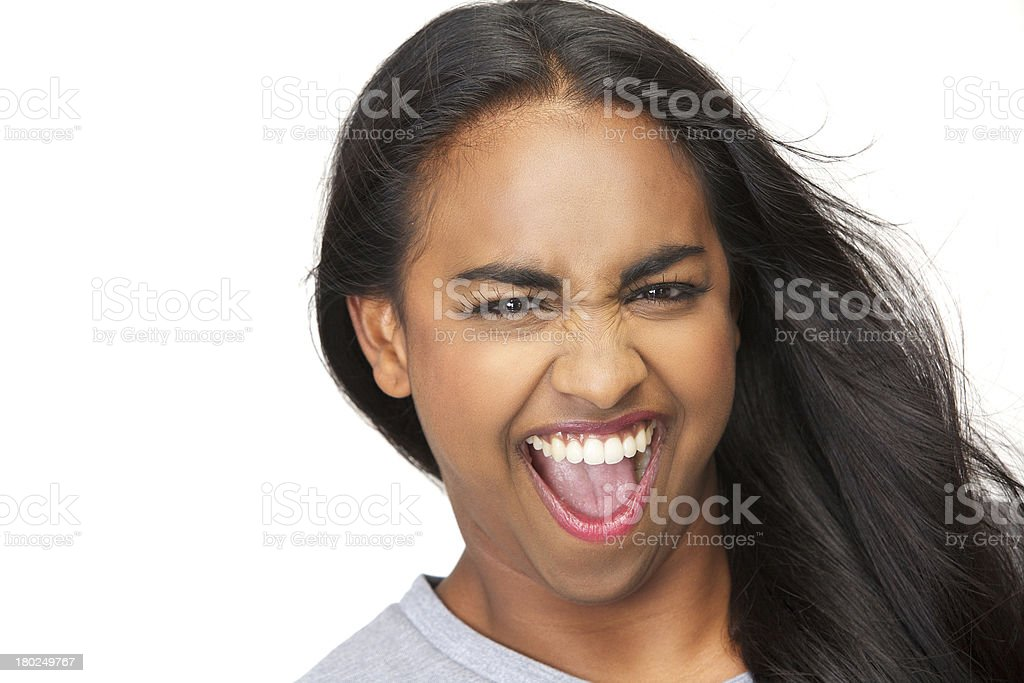 Portrait of an excited young woman with mouth open stock photo