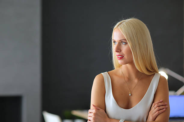 Portrait of an executive professional mature businesswoman sitting on office stock photo
