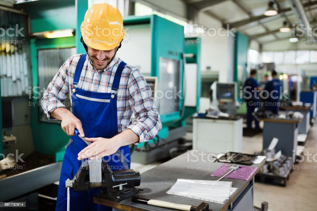 Portrait of an handsome engineer in a factory stock photo